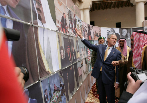 bush-points-to-a-photo-of-his-father-president-george-hw-bush-as-he-visits-al-murabba-palace-and-national-history-museum-saudi-arabia.jpg